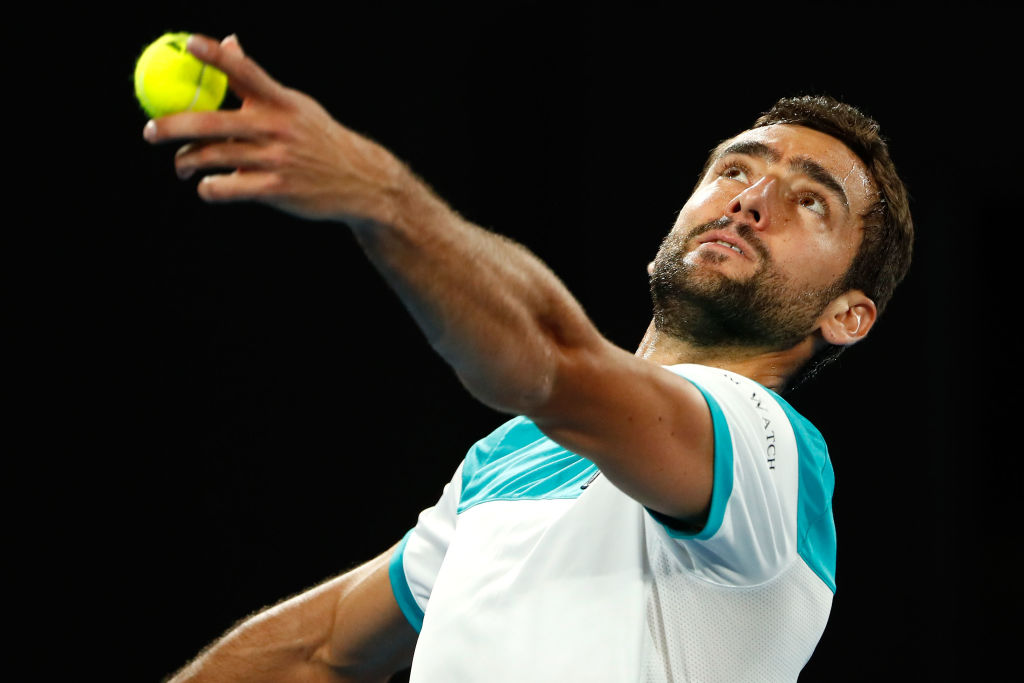 XXX of ZZZ plays a XXXX in his Men's singles final match against XXXX of ZZZZ on day 14 of the 2018 Australian Open at Melbourne Park on January 28, 2018 in Melbourne, Australia.